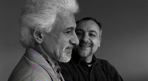 Poet Hossein Sharang (left) and photographer Babak Salari meet to recreate an old photo of the pair upon their first meeting many years prior.