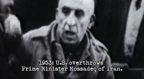 The first victim of American meddling in foreign affairs depicted in the montage is the democratically elected Mohammad Mossadeq.