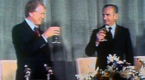 The opening credits feature a well-crafted montage of historical footage that includes this famous New Year's Eve toast between Jimmy Carter and Shah Mohammad Reza Pahlavi in which Carter told the Shah, 'Iran is an island of stability in one of the more troubled areas of the world.'