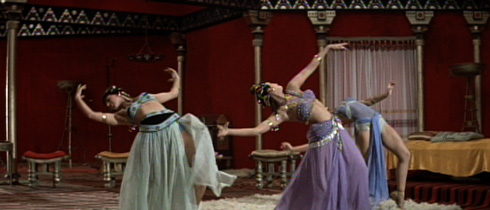 In a scene that likely made the cut of the sensationalist movie trailers typical of the sixties, slave girls of the exotic east perform their hypnotic dances.