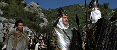 Hydarnes (Donald Houston) leads a contingent of Immortals with the aide of a treacherous Greek goat herder on a path that will allow them to envelop the Spartans.