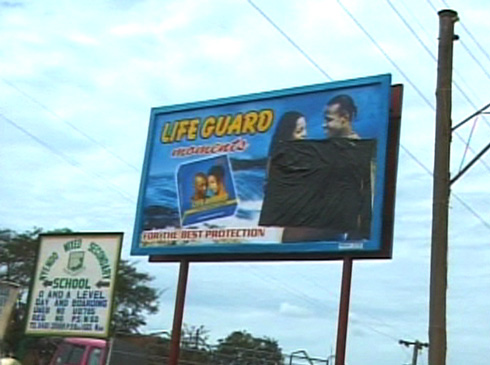 A billboard for condoms that has been partially covered up so as not to offend.