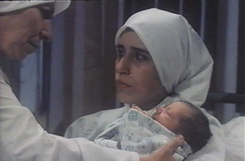 Valeh's wife Maryam (Zohreh Sarmadi) gives birth to their child as he is getting arrested.