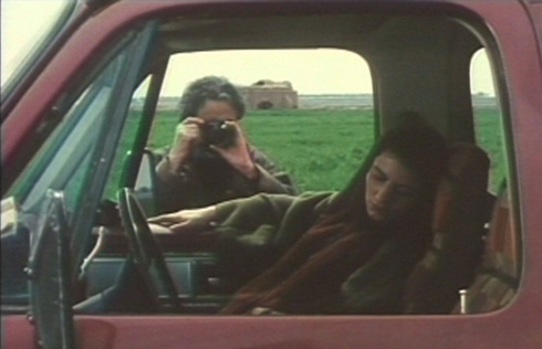 The photographer husband (Nezam Manouchehri) and sleeping wife (Leila Hatami).