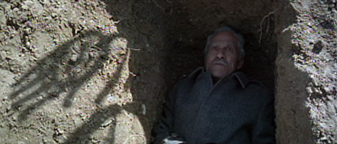 Mamo the musician (Ismail Ghaffari), who often takes to lying in open graves, is haunted by visions of his own demise.