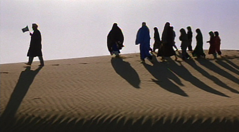 Robbed of their transportation, the group must walk the rest of the journey - carrying only their U.N. flag for protection.