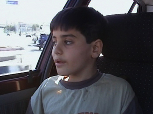 Young Amin (Amin Maher) is upset over his mother's divorce of his father.