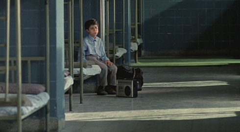 Young Mohammad (Mohsen Ramezani) patiently waits for his father to pick him up from the Institute for the Blind.