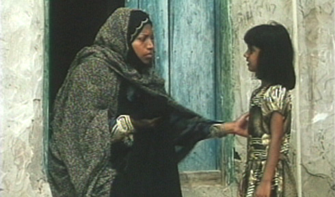 Young Hava is told that she must be fitted for a chador because at 12:00 she will turn nine-years-old.