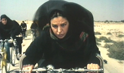 The rider's wife, Ahoo, refuses to stop riding her bicycle even with the threat that she will be divorced and ostracized from her family and tribe.