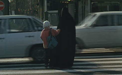Getting a little help crossing the hectic streets of Tehran.
