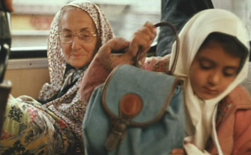 An old lady (Mohtaram Shirzad) reminds Bahareh to yield her seat to her elders.